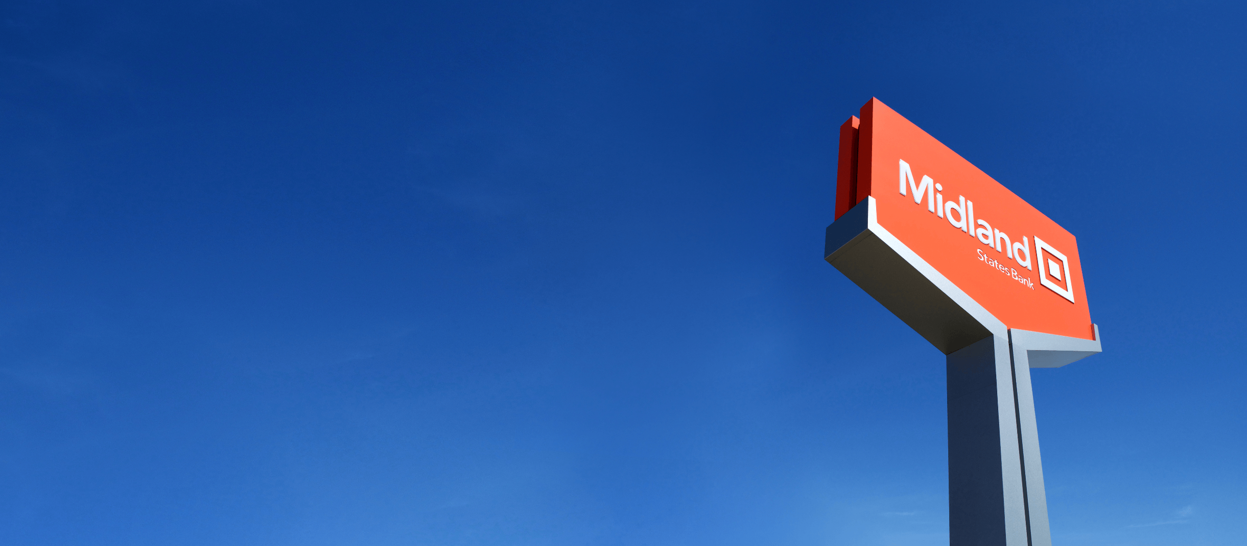 Midland States Bank sign in front of blue sky