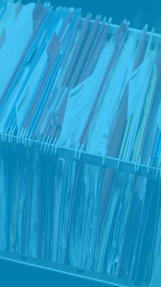 Filing cabinet stuffed with papers and unopened envelopes with blue overlay