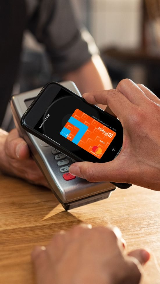 man buying coffee with mobile wallet on phone