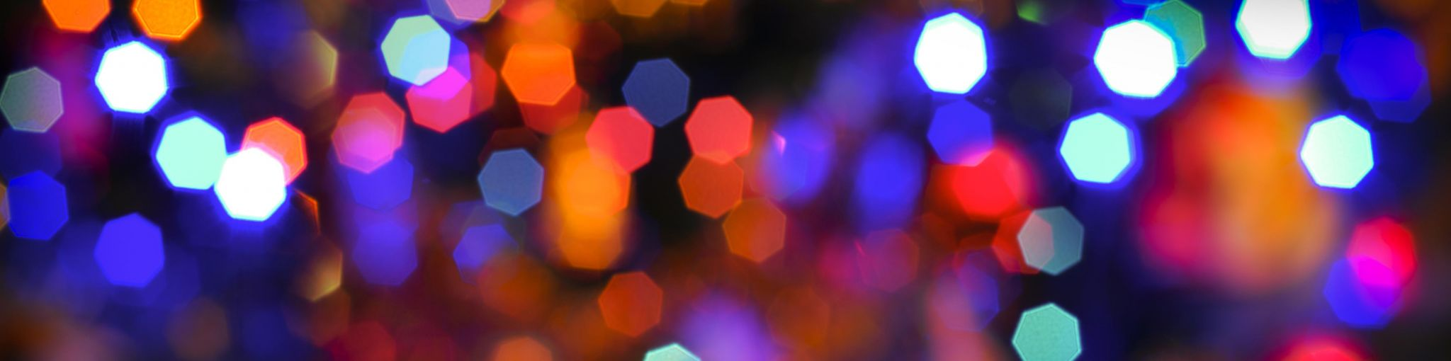 Many bokeh rainbow lights in the night