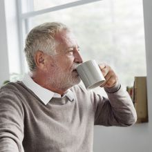 Older man sipping coffee